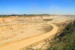 Sand pit on a sunny day. POLEWOJE, KALININGRAD REGION, RUSSIA — JUNE 18, 2014: Sand pit on a sunny day Stock Photos