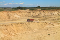 Sand pit on a sunny day. POLEWOJE, KALININGRAD REGION, RUSSIA — JUNE 18, 2014: Sand pit on a sunny day Royalty Free Stock Image