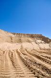 Sand pit with traces of tractor Royalty Free Stock Image