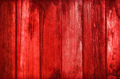 Sand on planked wood background in red colors Royalty Free Stock Photos