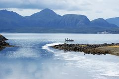 Sand Point Alaska Fishing. Salmon Fishing boat in Sand Point, Alaska during 2018 Salmon Fishing Derby with blue water and mountains in the background royalty free stock photo