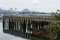 Sand Point Alaska Pier. Sand Point, Alaska Fishing Pier and harbor with reflections in water. September 1, 2018 royalty free stock photography