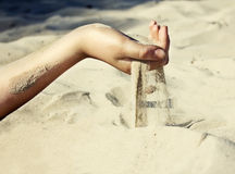 Sand is pouring through his fingers Royalty Free Stock Photo