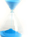 Sand pouring on hourglass suggesting deadline concept Royalty Free Stock Image