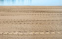 Sand on public beach after being graded and sifted for debris royalty free stock images