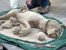 Sand puppet. Dogs hand made out of sand in Dublin city, Ireland Stock Photo
