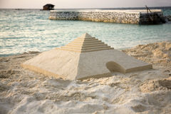 Sand pyramid on the beach Royalty Free Stock Image