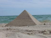 Sand pyramid Stock Images