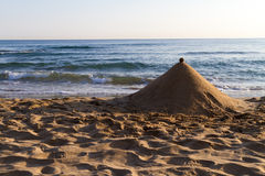 Sand pyramid structure on a beach. Royalty Free Stock Photography