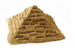 Sand pyramide. Isolated on the white background stock images