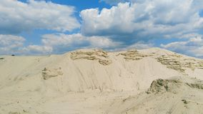 Sand quarry against the sky with clouds, Kiev, Ukraine, summer 2016 Stock Photos