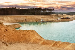 Sand quarry with blue lake under the sky. Royalty Free Stock Photos
