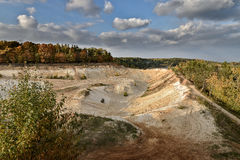 Sand quarry in the early autumn. Royalty Free Stock Photo