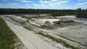 Sand quarry with excavator and truck ners lake bird eye view