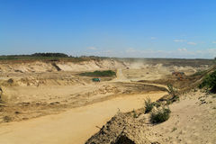 Sand quarry, mining. POLEWOJE, KALININGRAD REGION, RUSSIA — JUNE 18, 2014: Sand quarry, mining in the sunny day Royalty Free Stock Image