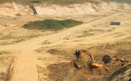 Sand quarry, mining. POLEWOJE, KALININGRAD REGION, RUSSIA — JUNE 18, 2014: Sand quarry, mining on a sunny day Stock Images