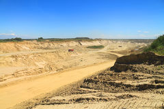 Sand quarry, mining in the sunny day. Sand quarry, mining in the sunny day Royalty Free Stock Images