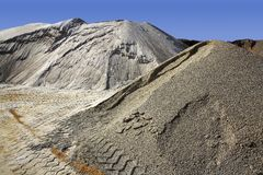 Sand quarry mounds of varied sands color Stock Image
