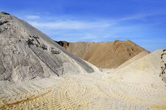 Sand quarry mounds of varied sands color Royalty Free Stock Photo