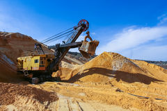 "Sand quarry. Near the town of Orikhiv in Zaporizhzhia region of Ukraine. Excavator caterpillar electric power shovel EKG"" 4,6 , with bucket capacity of five Royalty Free Stock Photography"