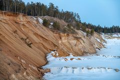 Industrial sand quarry for road construction in winter royalty free stock photo