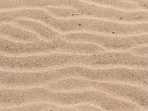 Sand ripples background Stock Images