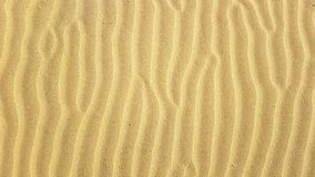 Sand ripples texture pattern shaped with strong wind on the sandy summer beach stock image