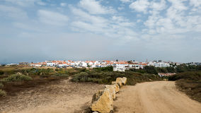 Sand road in Algarve. A sand road surrounded by trees leading through the portuguese Algarve Royalty Free Stock Photos