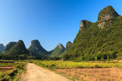 Sand road through a valley with limestone rocks Royalty Free Stock Photo