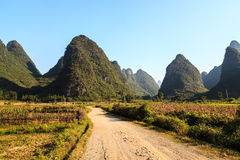 Sand road through a valley with limestone rocks Stock Image