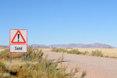 Sand in road warning sign Stock Image