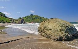 Sand and Rocks on a Pacific Coast Beach Stock Photo