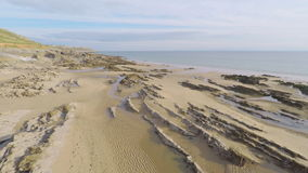 Sand and Rocky Beach stock video footage