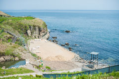 sand on the rocky beach royalty free stock photos