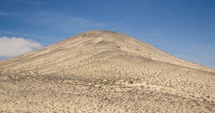 Sand and rocky mountains in Fuerteventura Stock Images