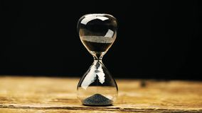 Hourglass measuring the passing time