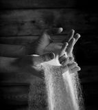 Sand running through hand Stock Images