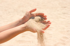 Sand running through hands Stock Photo
