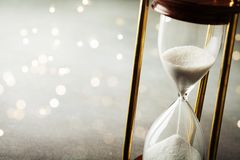 Sand running through the hourglass. Time keeper concept. Boke effect. Sand running through the hourglass. Time keeper concept stock photo