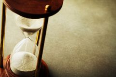 Sand running through the hourglass. Time keeper concept. Sand running through the hourglass. Time keeper theme stock photography