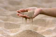 Free Sand Running Through Hand Of Woman Stock Photography - 76530472