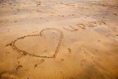 Sand-Schreiben Lizenzfreies Stockbild