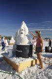 Sand sculptress uses trowel Stock Image