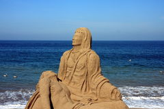 Sand sculpture. On the ocean shore in tropical area Royalty Free Stock Image