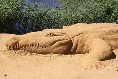 Sand sculpture alligator Stock Photo