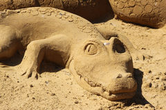 Sand sculpture alligator Stock Image