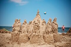 Sand Sculpture on Beach Under Blue Sky Royalty Free Stock Image
