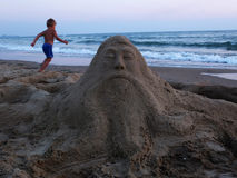 Sand sculpture and boy Stock Photography