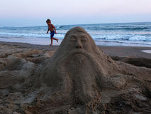 Sand sculpture and boy Stock Photos