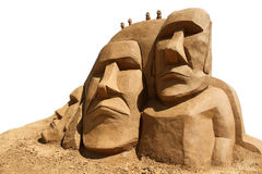 Sand sculpture Easter island isolated. Sand sculpture: Easter island stylized men isolated on white background Royalty Free Stock Images
